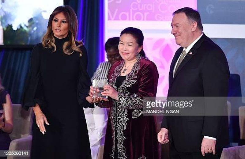 International Women of Courage (IWOC) Award recipient Sayragul Sauytbay of Kazakhstan poses with US Secretary of State Mike Pompeo (R) and First Lady Melania Trump at the State Department in Washington, DC on March 4, 2020. (Photo by MANDEL NGAN / AFP) (Photo by MANDEL NGAN/AFP via Getty Images)